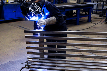WEC group Apprentices welding steel bench